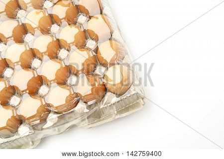 Fresh eggs in package on White Background