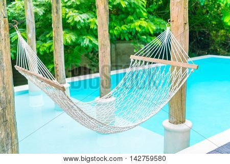 White hammocks in Luxury swimming pool