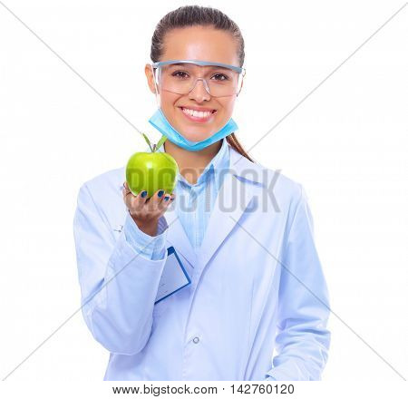 Smiling woman doctor with a green apple.