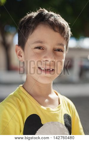 Portrait close up of a sweet child smiling missing milk tooth