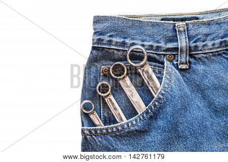 chrome lug spanner in front blue jeans pocket on white isolated background. Copy space for text poster