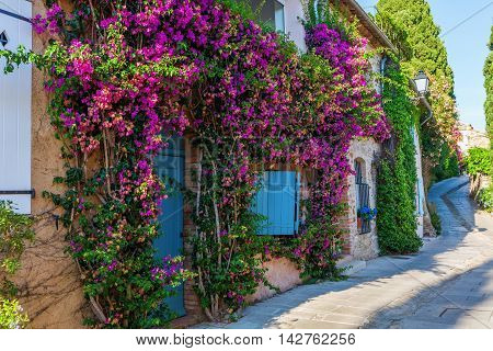 alley in the picturesque Provencal village Grimaud France poster