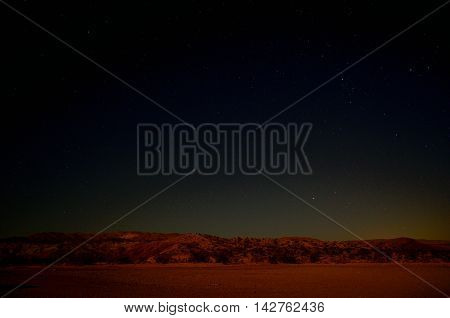 An Open Desert Landscape at Night with Clear Skies