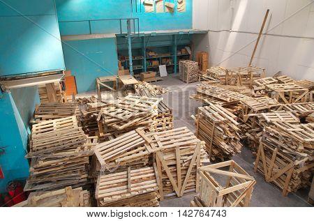 Dump of warehouse pallets.