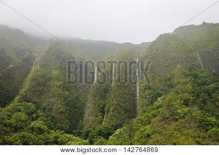Heavy rain waterfalls in the Ko'olau mountains on Oahu, Hawaii
