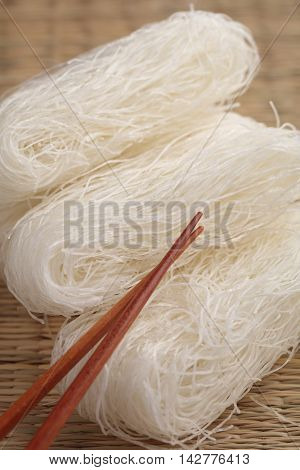 Cellophane noodles on a straw mat