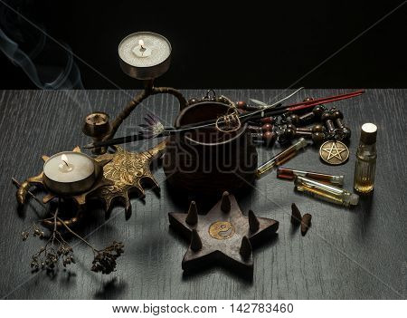 Still life with magic objects, evil candles. Fortune telling seance or black magic ritual. Scary still life with occult and esoteric symbols. Halloween or divination rite