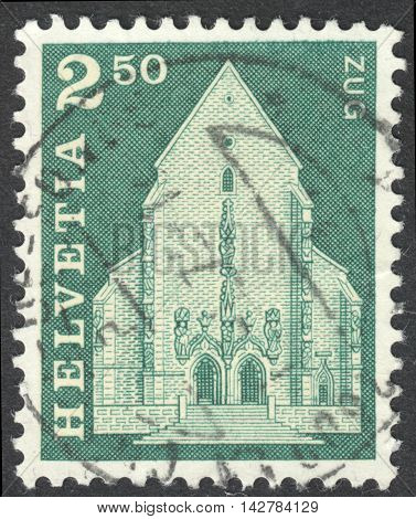 MOSCOW RUSSIA - CIRCA JUNE 2016: a post stamp printed in SWITZERLAND shows St. Oswald's Church Zug circa 1967