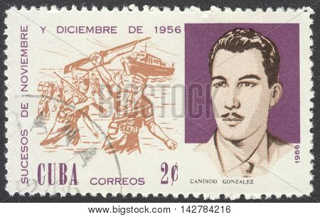 MOSCOW RUSSIA - CIRCA JULY 2016: a post stamp printed in CUBA shows C. Gonzalez and Beach Landing the series