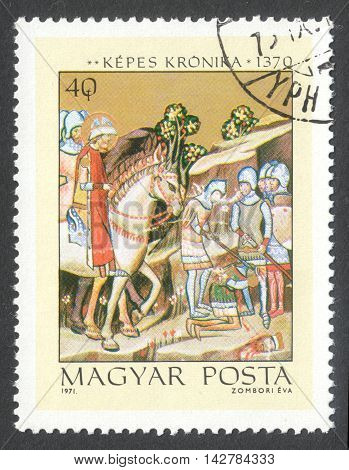MOSCOW RUSSIA - CIRCA JUNE 2016: a post stamp printed in HUNGARY shows The Beheading of Heathen Chief Koppany the series