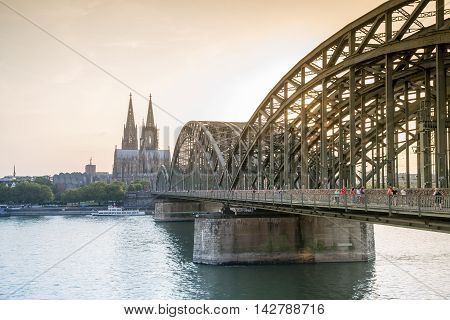 Koln Cityscape With Cathedral And Steel Bridge, Germany