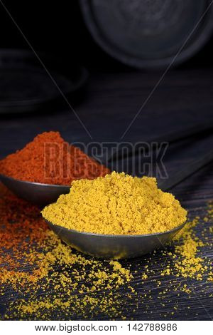 Mixed spices on a dark wooden background with copy space