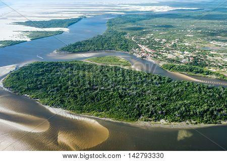 Aerial View Of Lencois Maranhenses National Park, Brazil, Low, Flat, Flooded Land, Overlaid With Lar