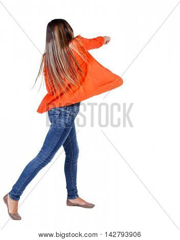 back view of woman funny fights waving his arms and legs. Rear view people collection. backside view of person.  Isolated over white background. student in red jacket hand strikes.