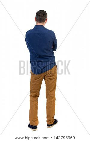 Back view of man . Standing young guy. Rear view people collection.  backside view of person.  Isolated over white background.a man in a blue shirt with the sleeves rolled up, standing with her hands