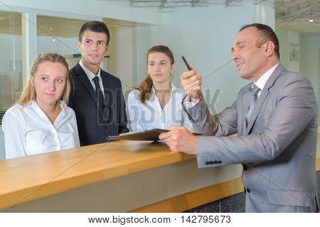 Hotel staff following supervisor's gaze