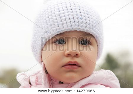 Beautiful baby girl with white hat