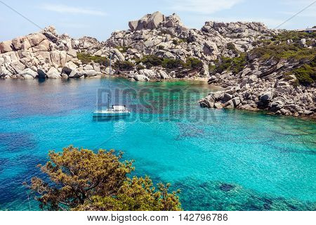 Picturesque view of Capo Testa beach with lonely yacht in Sardinia Italy