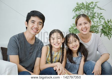 Happy Asian Family sitting together in the living room