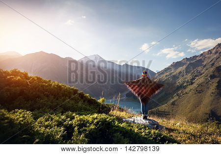 Woman In Poncho At The Mountains