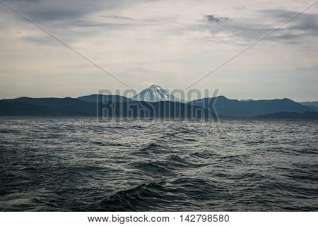 Waves leading the eye to Vilyuchinskaya Vulcano across Avacha Bay, Kamchatka, Russia