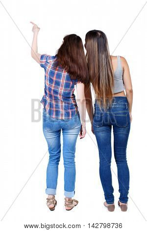 Back view of two pointing young girl. Rear view people collection.  backside view of person. beautiful woman friends  showing gesture. Rear view. Isolated over white background. Two young girls in