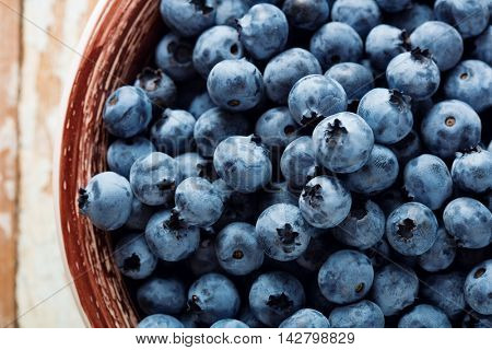 Top view of ripe blueberries in the bowl.