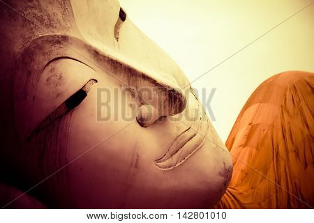 Close up lying white buddha statue at Wat Khun Inthapramun Ang Thong Province Thailand