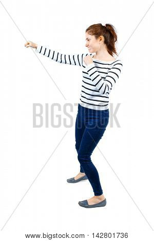 back view of woman funny fights waving his arms and legs. Rear view people collection. backside view of person.  Isolated over white background. Girl in a striped sweater boxing.