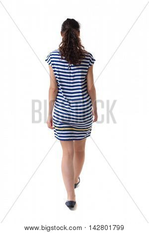back view of walking  curly woman.  backside view of person.  Rear view people collection. Isolated over white background. Swarthy girl in a checkered dress comes back to us.
