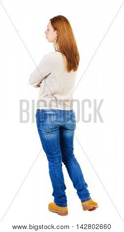 back view of standing young beautiful  woman.  girl  watching. Rear view people collection.  backside view of person. Girl in a white jacket standing with arms folded and looking to the left.