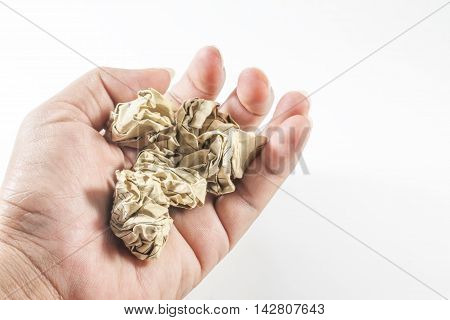 Crumpled paper in hand on white background