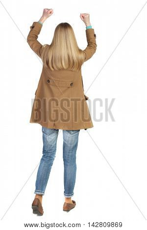 Back view of  woman.  Raised his fist up in victory sign.    Raised his fist up in victory sign.  Rear view people collection.  backside view of person.  Isolated over white background. The blonde in