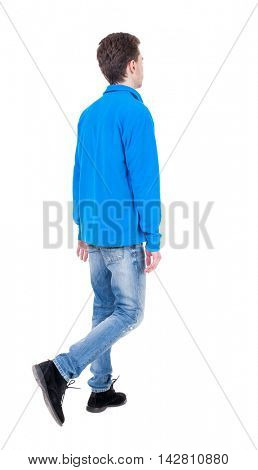 Back view of going  handsome man. walking young guy . Rear view people collection.  backside view of person.  Isolated over white background. Curly boy in blue sweater goes with her hands.