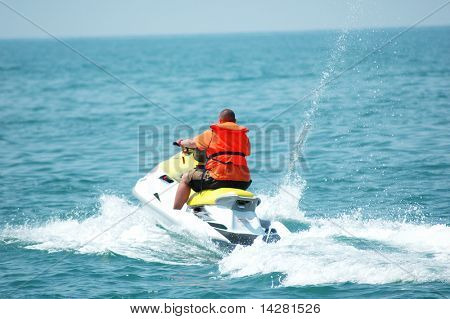 Man driving a motorised scooter at sea - more similar photos in my portfolio