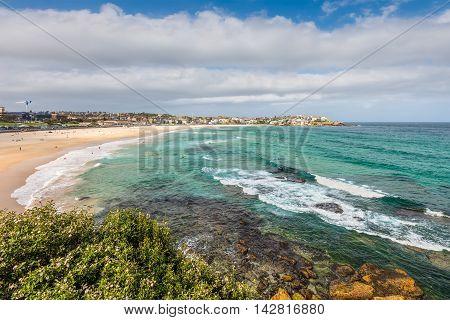 Bondi Beach in Sydney Australia. Bondi Beach is located 7 km (4 mi) east of the Sydney central business district in the Eastern Suburbs.