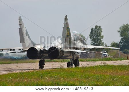 Kiev Region Ukraine - August 3 2012: Ukraine Air Force MiG-29 is taxiing to the runway for a training flight
