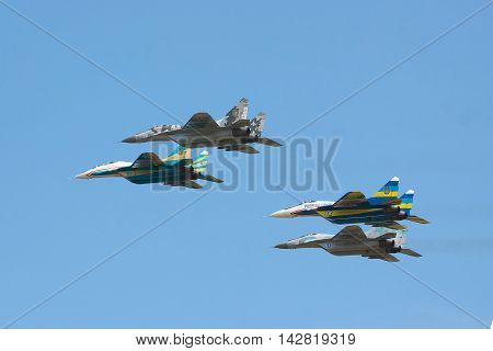 Kiev Region Ukraine - August 3 2012: A group of Ukraine Air Force MiG-29's is performing a training flight