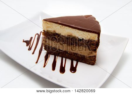 cherry strudel food on the plate with chocolate syrop isolated on whithe background