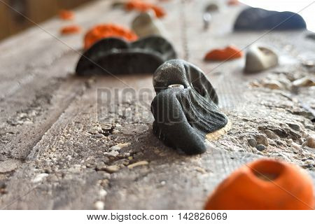 Climbing wall with selective focus, low angle view.