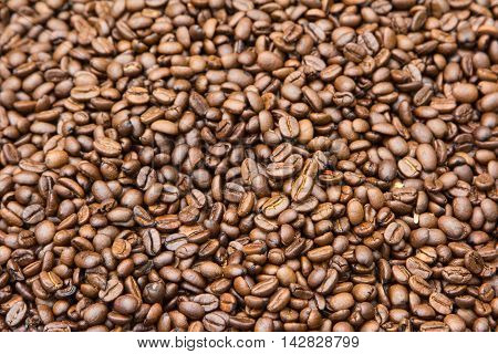Roasted Coffee Beans background texture. Arabic roasting coffee - an ingredient of hot beverage. Brown coffee beans for background and texture.