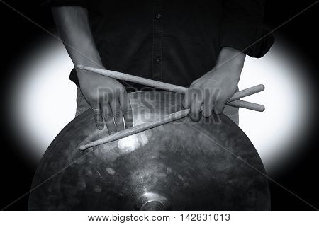 Hands holding drum sticks. Black and white photography
