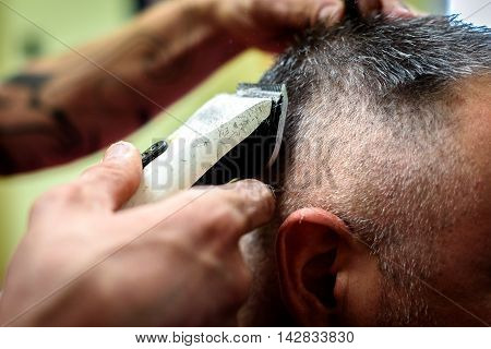 Close-up Of A Man Getting His Hair Shaved With Trimmer.
