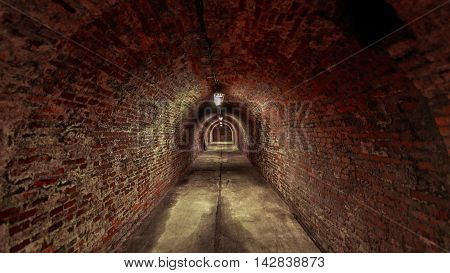 Long underground brick tunnel angle shot dark
