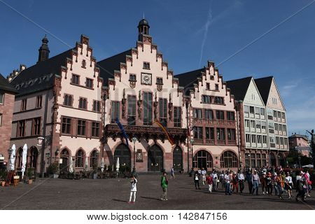 FRANKFURT AM MAIN, GERMANY - JUNE 14, 2015: Tourists in front of the Frankfurt City Hall also known as the Romer at the Romerberg in Frankfurt am Main, Hesse, Germany.