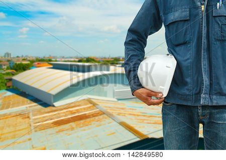 The engineering and safety helmets stood on the details of architectural metal roofing in commercial construction