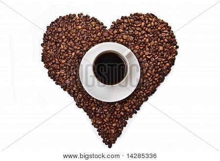 White Cup Of Coffee On Heart Shaped Coffee Beans