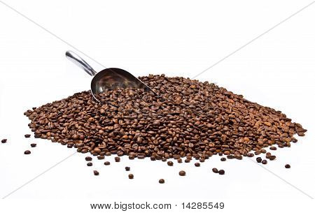 Metal Scoop Partially Burried In Coffee Beans Heap