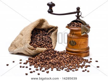 Coffee Beans Sack With Scattered Beans And Wooden Coffee grinder