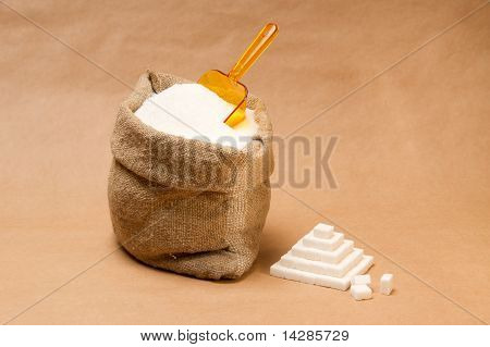 Sack With Sugar And Transparent Plastic Orange Scoop